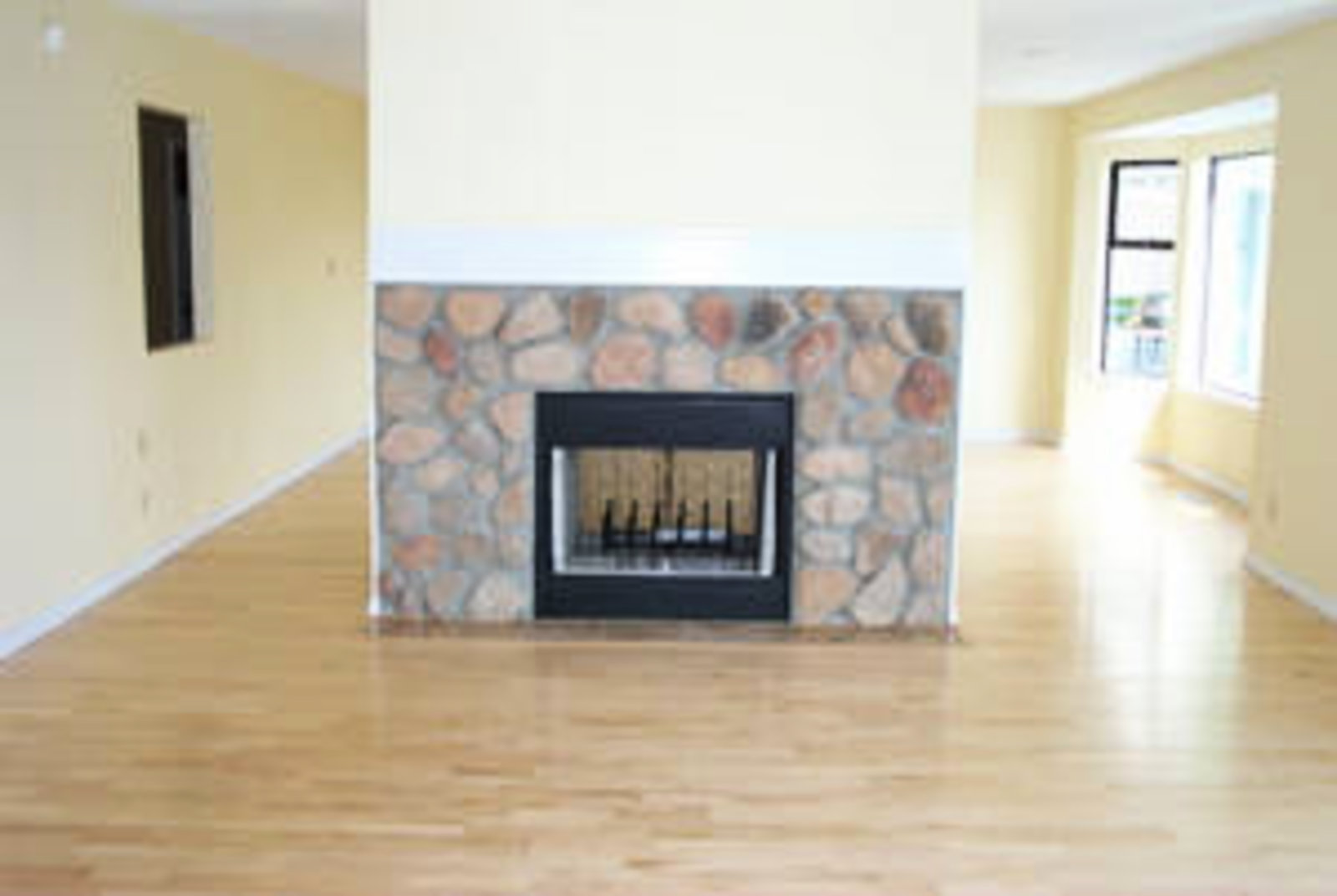Family Room Connects with kitchen, birchwood floors, wood burning fireplace.