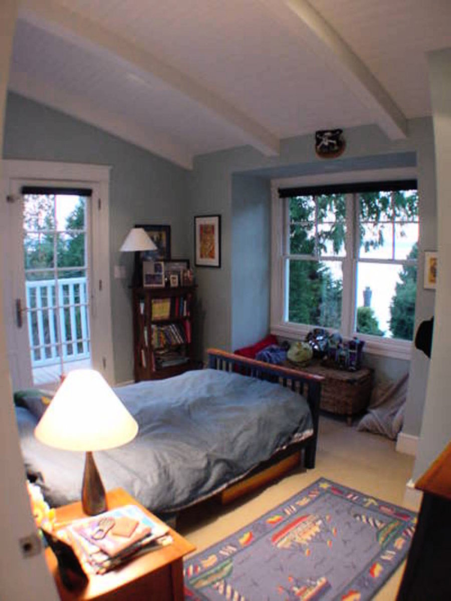 Upstairs Bedroom #2 Vaulted ceiling, french doors to sundeck, ocean view.