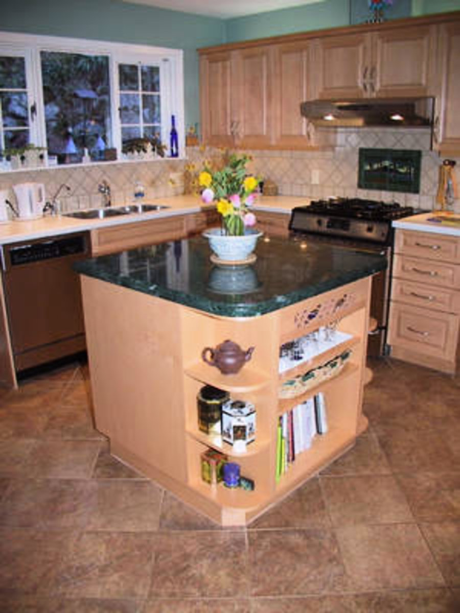 Kitchen New gourmet kitchen featuring maple cabinets, granite kitchen island, new appliances and tiled floors.