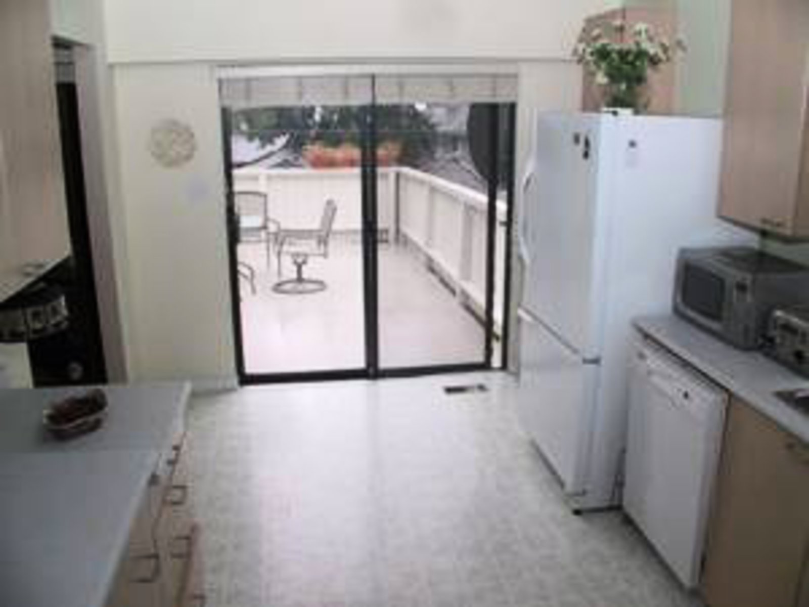 Kitchen Newer cabinets, appliances opening to sundeck