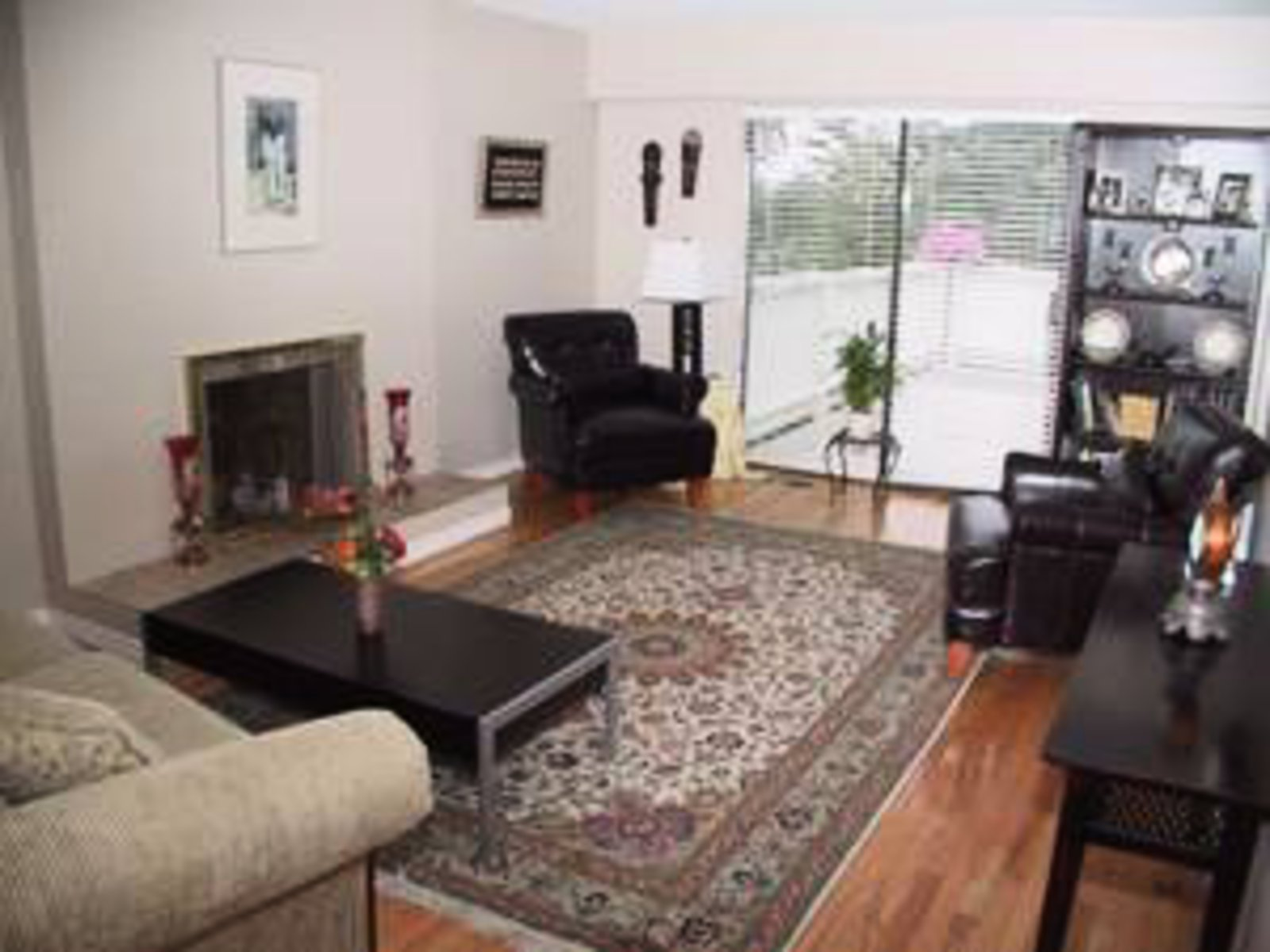 Living Room Hardwood floors, gas firepalce opening to kitchen and sundeck