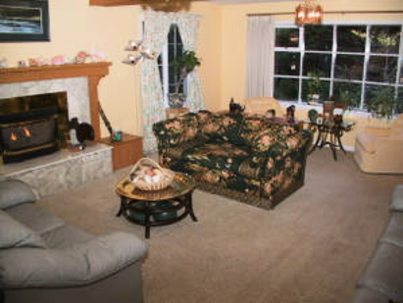 Living Room South Spacious living room with gas burning fireplace, bay window and 2 seating areas.