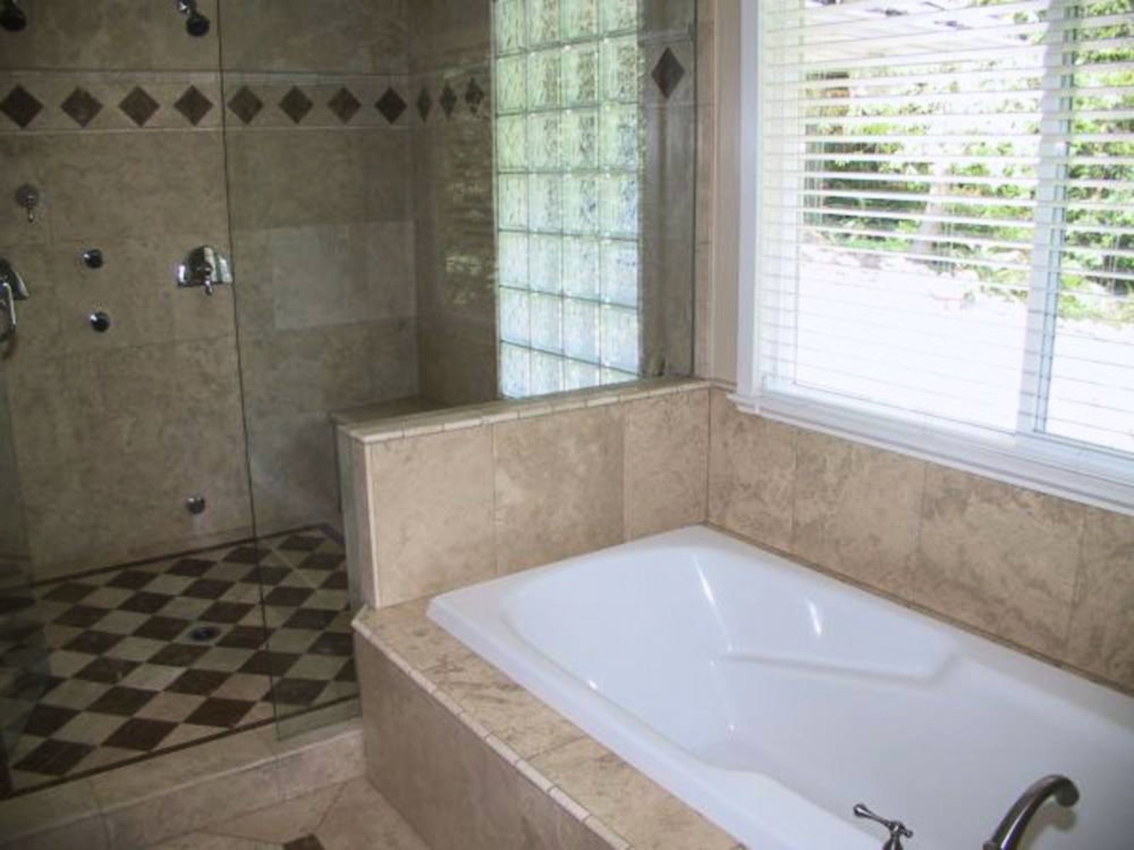 Oversized soaker tub and steam/shower
