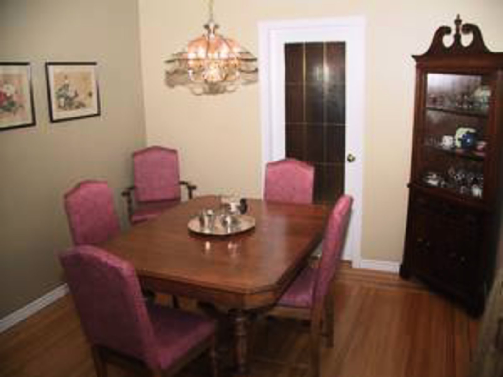 Dining Room Hardwood Floors.  Overlooks swimming pool