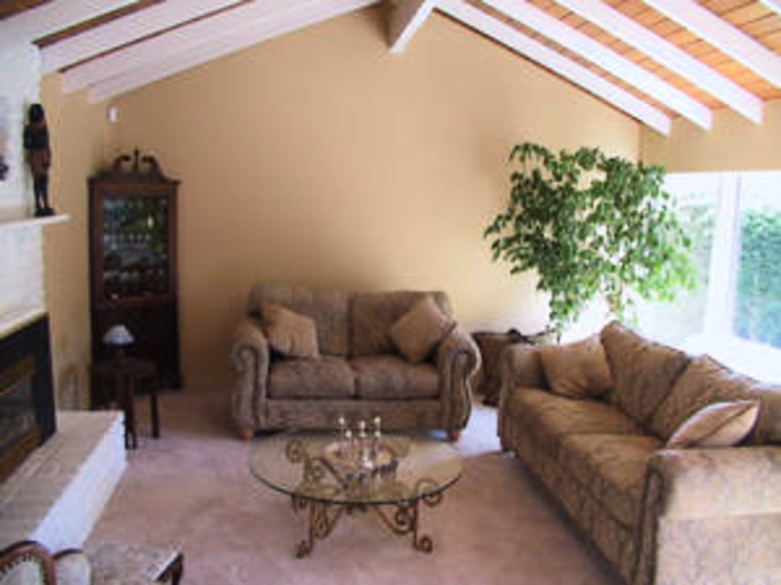 Living Room with gas fireplace and vaulted ceilings