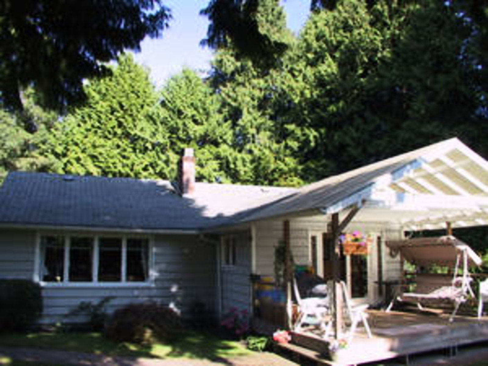 Back of Home West Facing with late afternoon sunshine.  Private 50 x 122 lot with green lane allowance for added privacy.