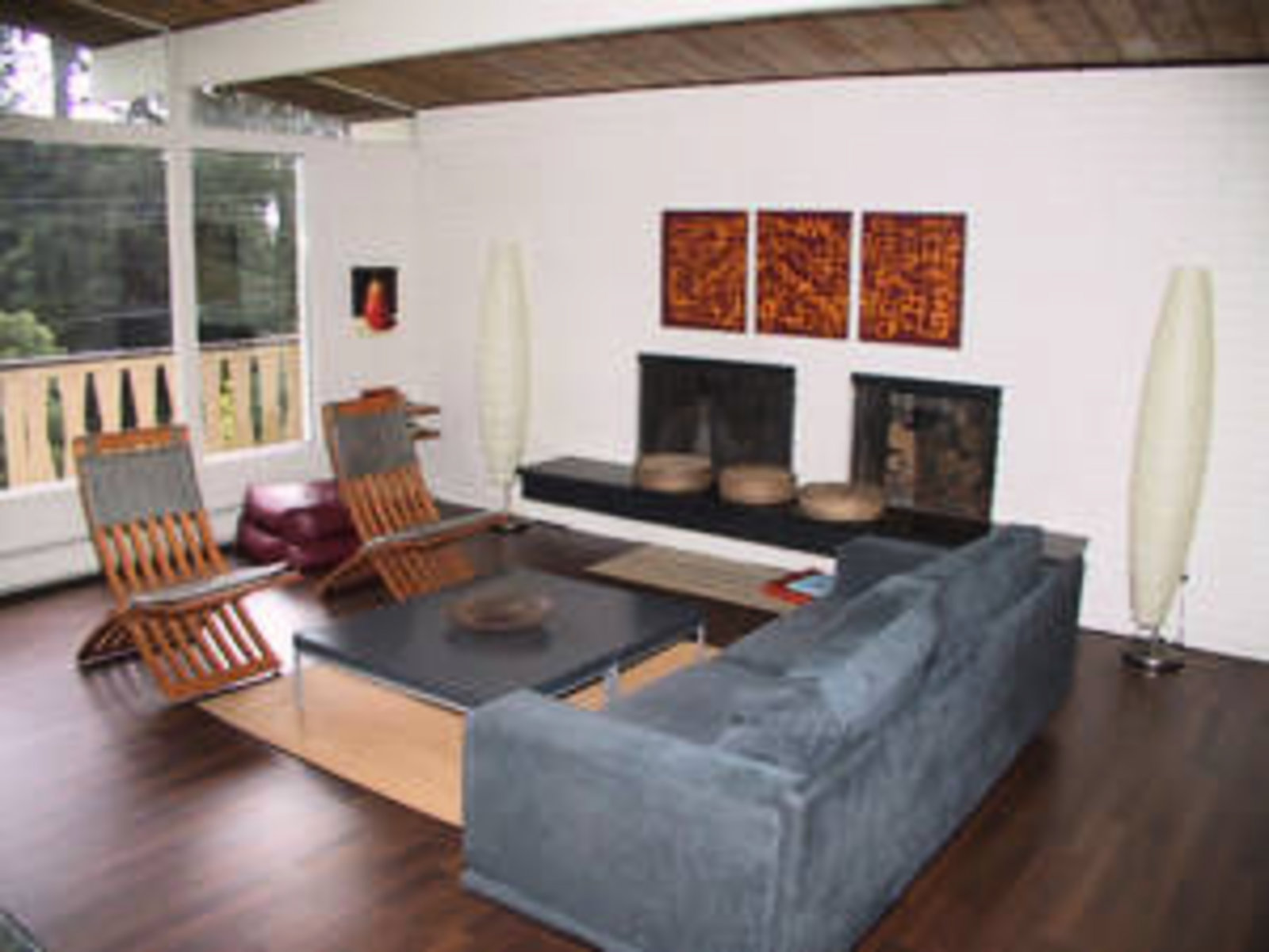 Living Room Vaulted Ceilings, hardwood floors, wood burning fireplace, floor to ceiling windows