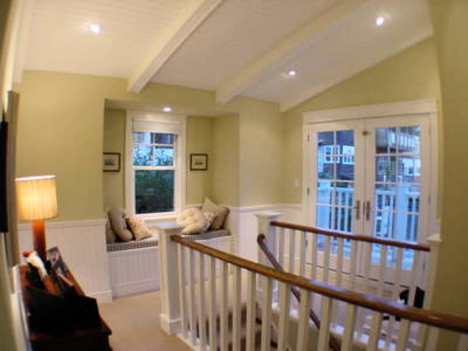 Upper Floor Landing French Doors leading to balcony, cozy bay window seat.